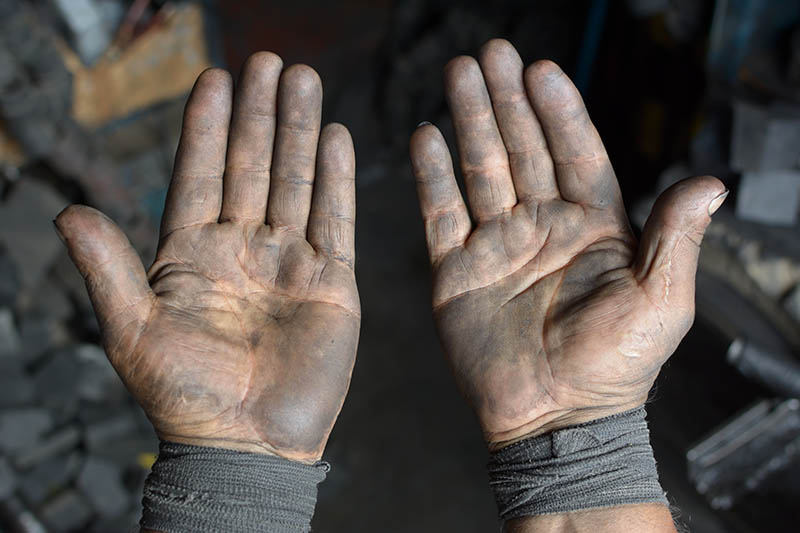 a photo of some filthy hands