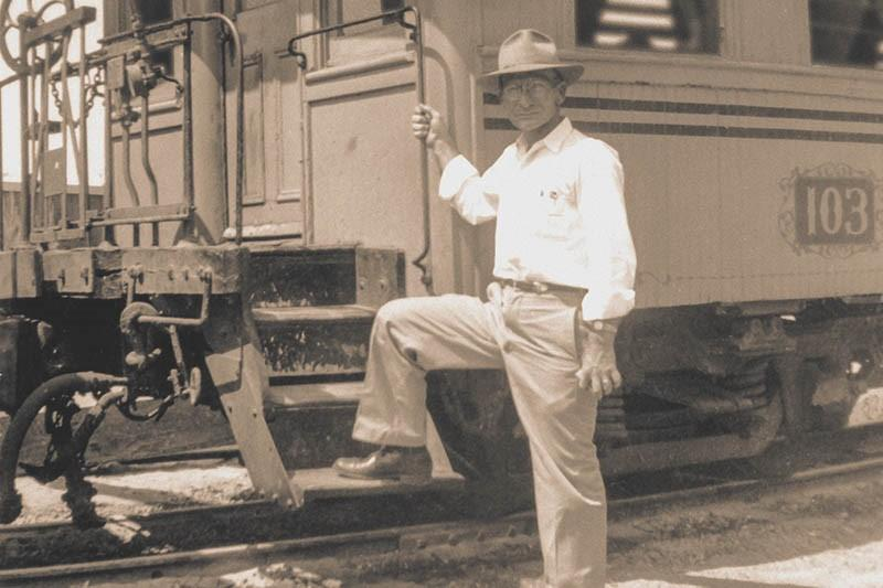 old photo of man by train